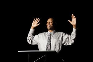 Lo Res Black speaker at podium animated